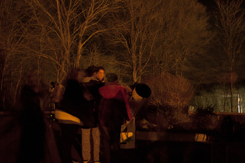 Greg Barker shows one the night's deep-sky targets to a girl scout at the Smith Library in North Branford.